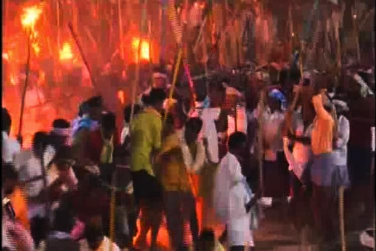 Devotees fighting with sticks as part of celebration