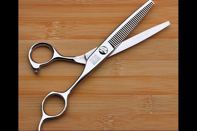 Karnataka school teacher chops off students hair to enforce discipline