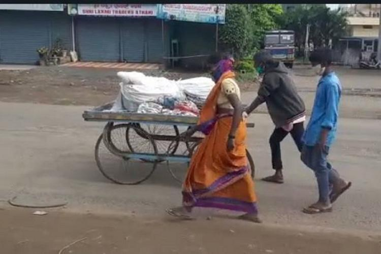 Wife and two sons pushing the dead body of a man