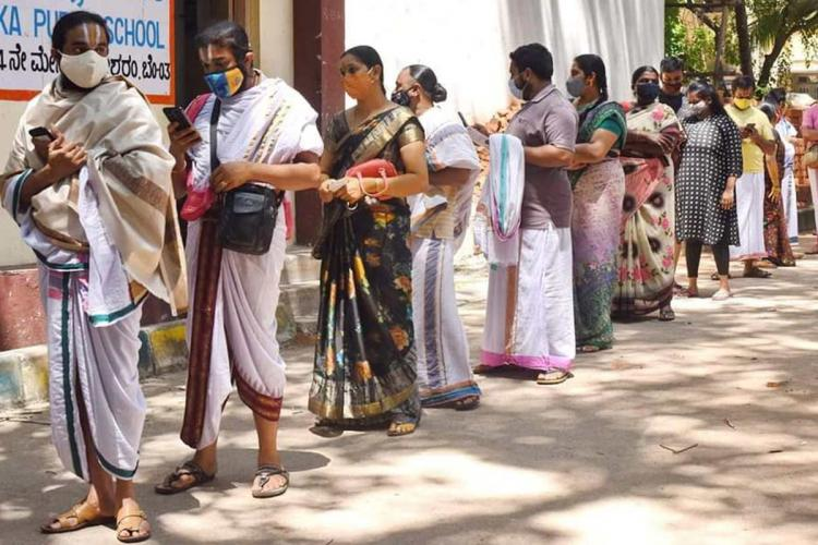 People waiting in line for the COVID-19 vaccine in Bengaluru during the day