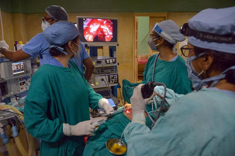 Doctors treating a patient in the operation room