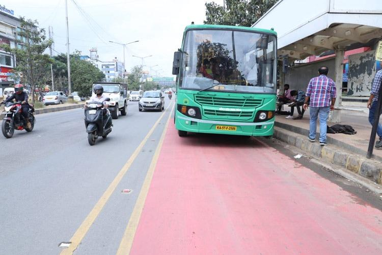 bengaluru bmtc bus halts at a designated stop on the bus lane on the outer ring road