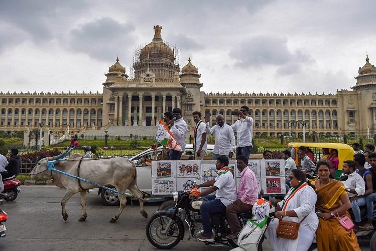 Karnataka leaders ride a horse buffalo to protest against fuel prices
