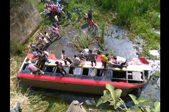 One person dies as bus falls 50 feet off bridge over 20 injured