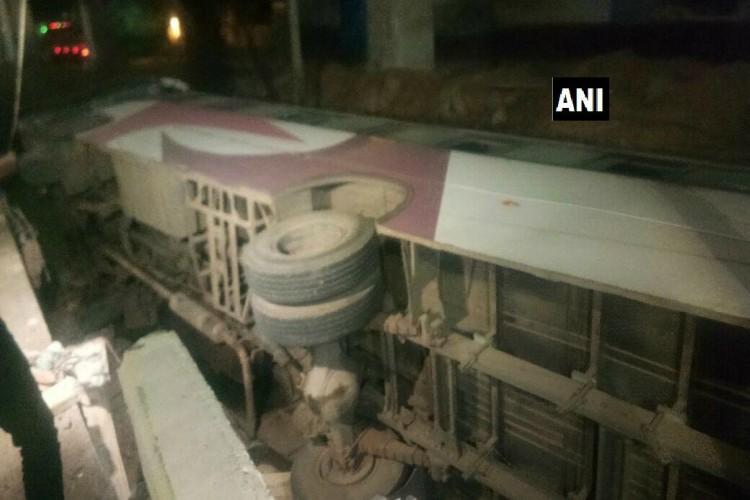 Bus with 50 people on board falls off Hyderabad flyover 1 injured all others safe
