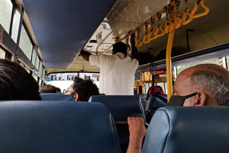 passengers inside a ksrtc bus are seen wearing masks and not maintaining physical distance