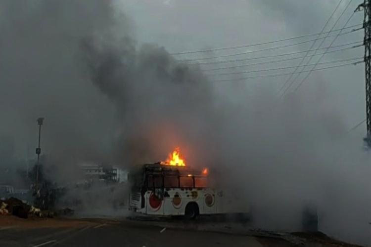Tourist bus catches fire after accident in Andhra 50 passengers rescued