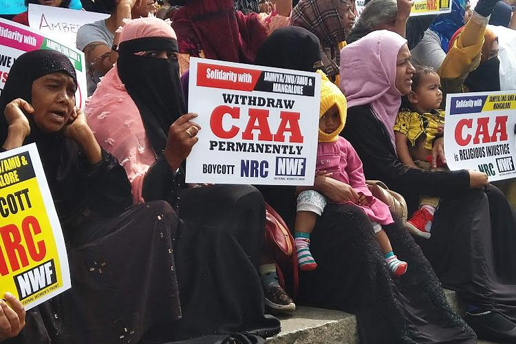 Hundreds of women turn up at Bengalurus Town Hall to protest draconian NRC CAA