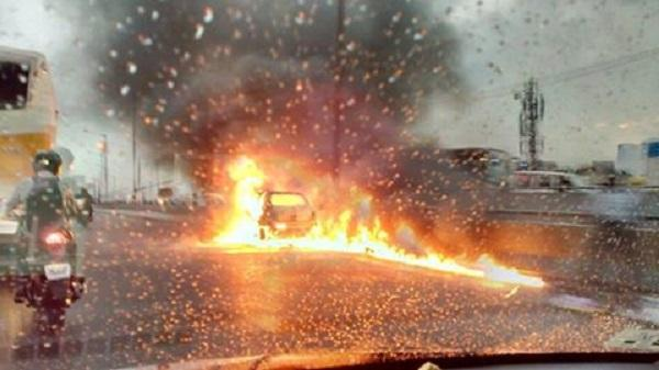 Car catches fire on busy Bengaluru flyover chokes traffic