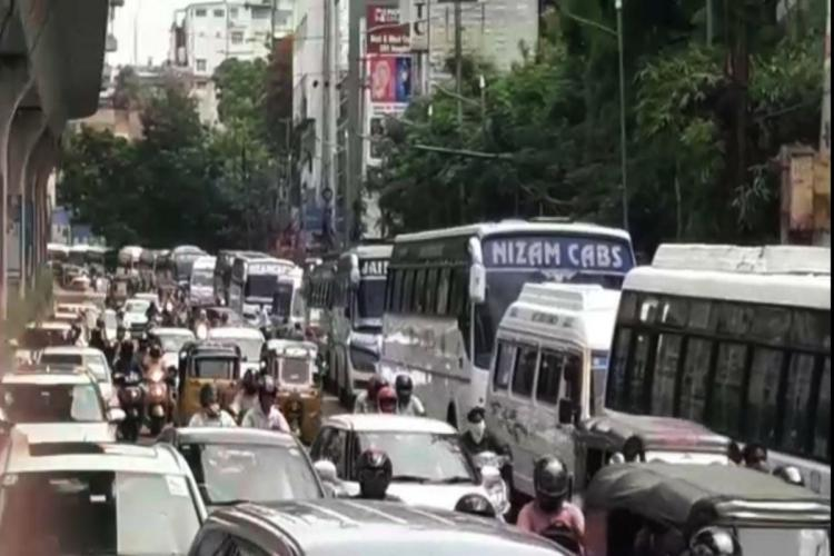 Cab and bus operators park vehicles at Hyd RTA office in protest ask for tax waiver