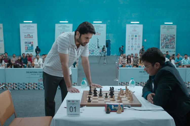 Nithiin playing chess in front of an audience in the film Check