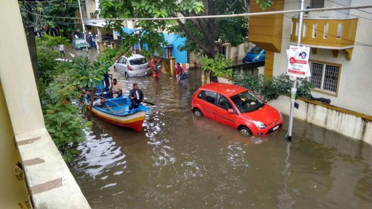 Boats on the roads buses under water Images from Chennai that show how bad it is