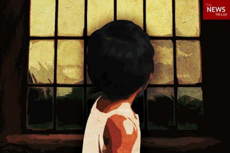 picture of child looking out the window