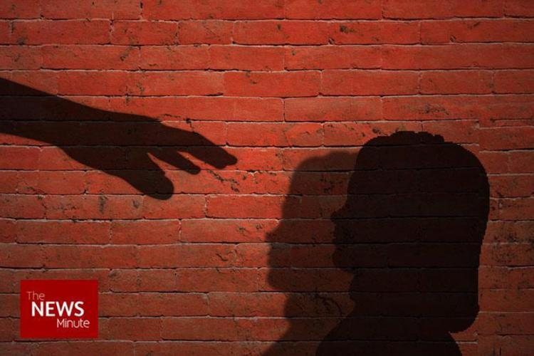 Child trafficking representational image with a person extending their hand at a child