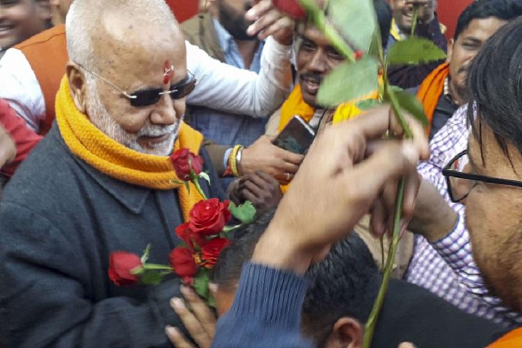 Granted bail rape accused Chinmayanand greeted with flowers outside jail