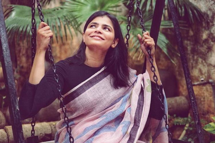 Singer Chinmayi on a swing wearing a saree