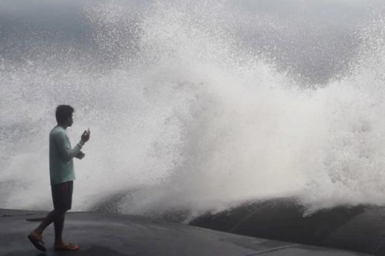 A man standing on the coast of Chellanam in Ernakulam watching the rough sea during cyclone Tauktae