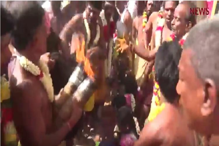 Going coconuts over God again Watch devotees get their head slammed by a priest in TN