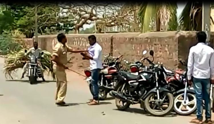 Video Karnataka cop thrashes man for parking bike on the roadside