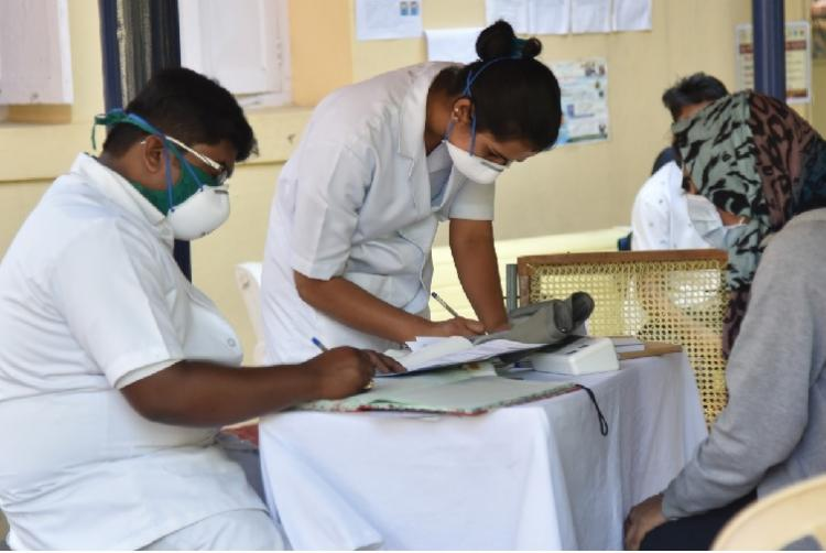 A medical profession getting details of a patient