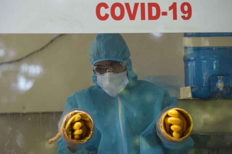 A medical professional in a COVID-19 booth