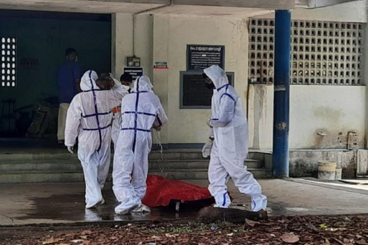 Last rites performed for a deceased coronavirus patient