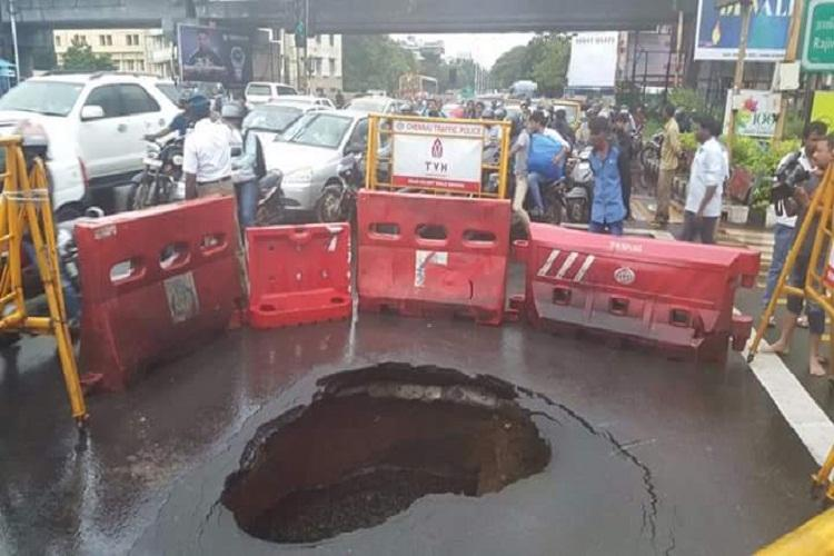 Road caved in at Chennais Madhya Kailash huge crater barricaded to avert accidents