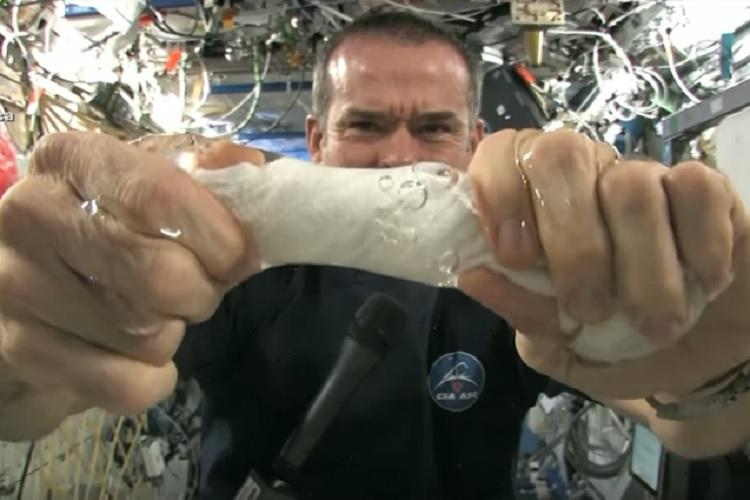 What happens when you wring out water in space Watch this awesome video