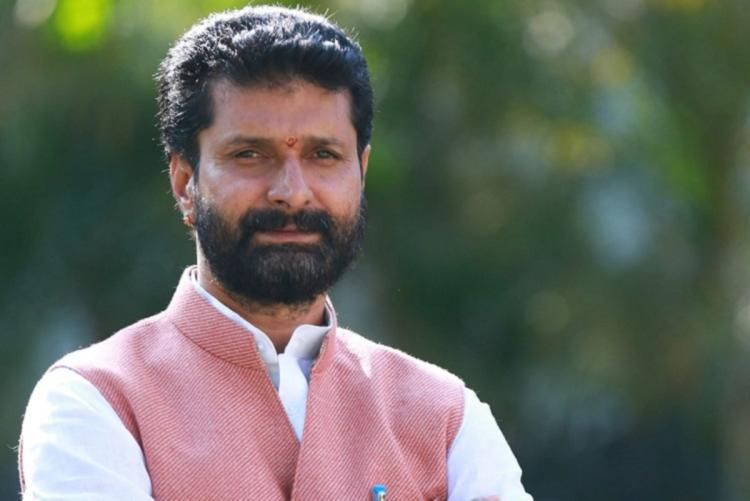 Karnataka Minister for Tourism and Kannada and Culture CT Ravi wearing a pink vest over a white shirt He has a beard and mustache His eyes are squinted due to the sunlight