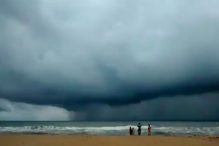 Dark clouds hanging low over the ocean in Chennai