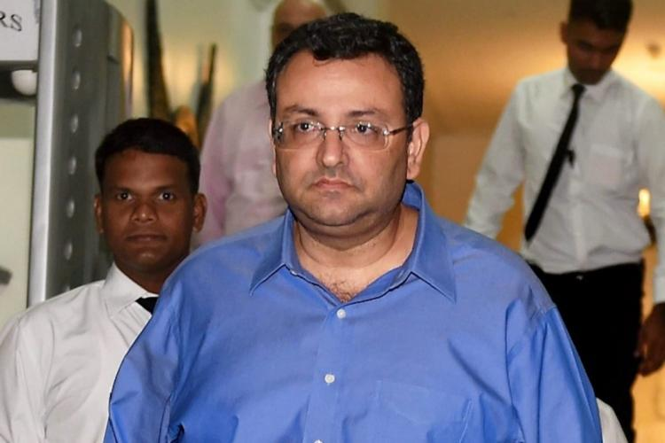 Cyrus Mistry in blue shirt