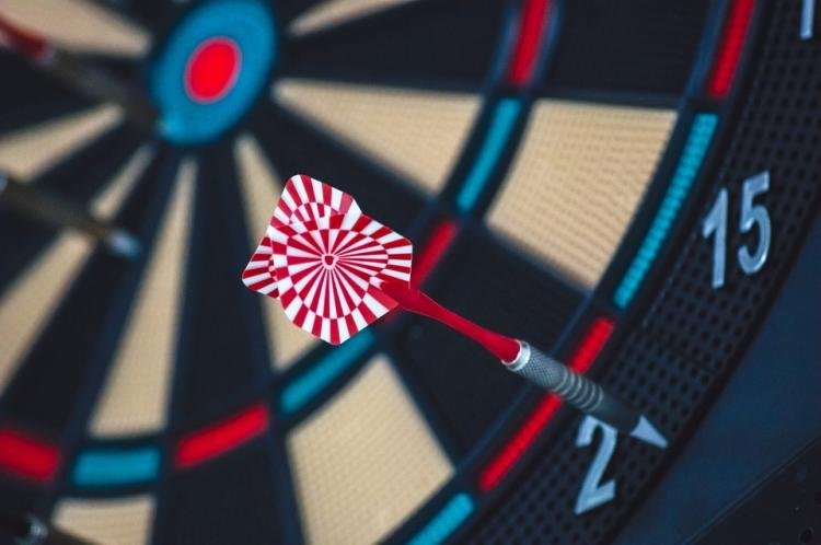 Why the dartboard looks like it does and how bad players can do better