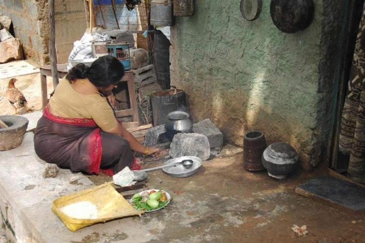 A woman cleaning vessels