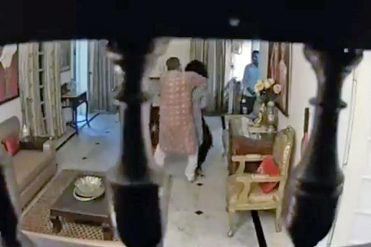 A screenshot of a video that shows a Madhya Pradesh police official assaulting his wife
