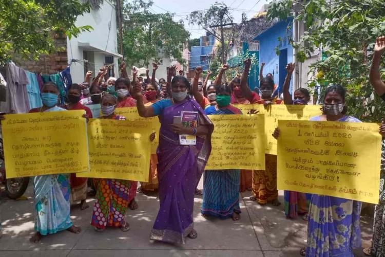 domestic workers in chennai protest holding yellow chart bearing their demands