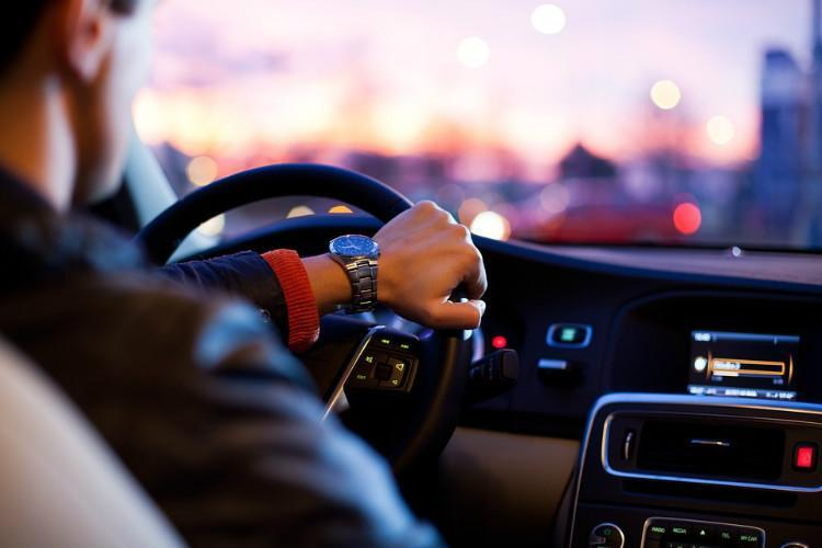 A driver holding the steering wheel
