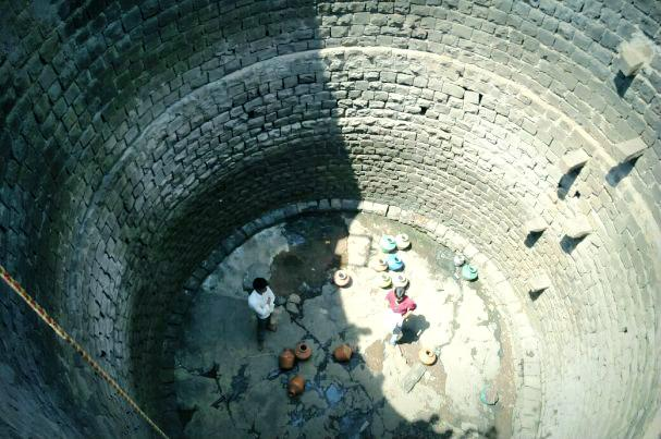 In bone dry Kalaburgi young girls forced to risk it all for a few pots of water