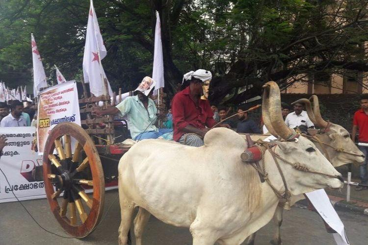 DYFI protests against petrol hike marches with bullock carts to central govt offices in Kerala