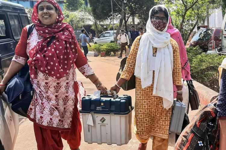 Polling officers carrying ballot boxes in West Bengal