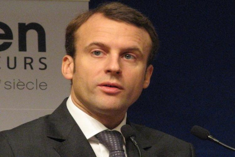 French President Emmanuel Macron wearing black suit and a tie