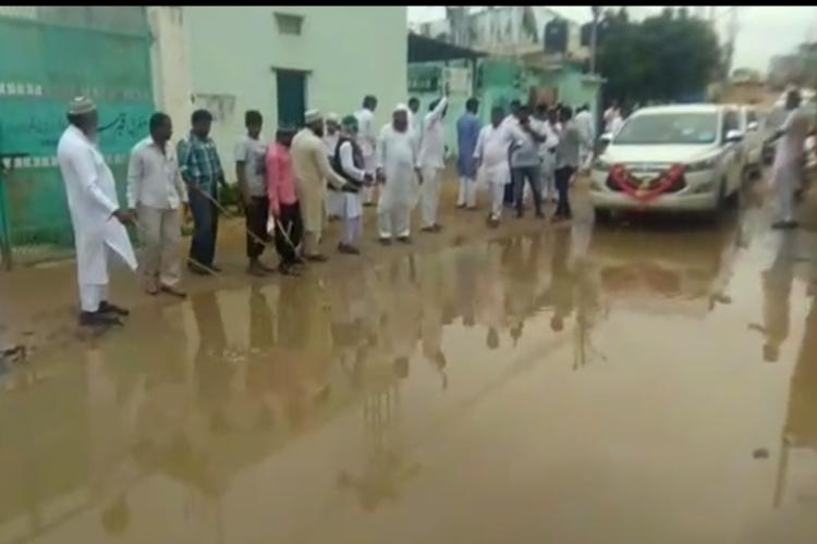 Residents of Hyderabads Prem Nagar go fishing on streets to protest waterlogged roads