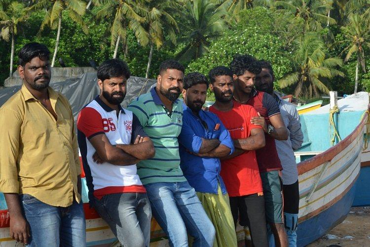 Rowing Between The Rooftops captures Keralas heroes The fishermen of the state