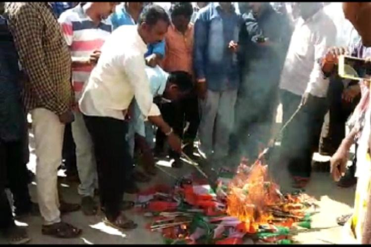 Congress supporters burn party flags after party gives ticket to TRS defector