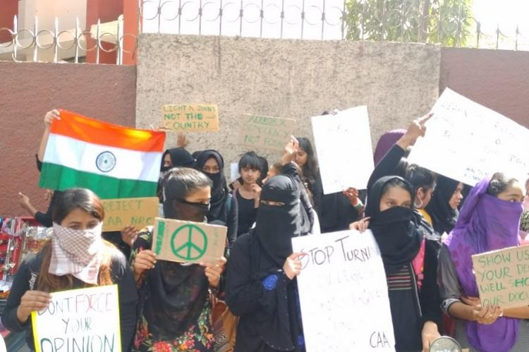 Day after altercation on pro-CAA banner Bengaluru Jyoti Nivas students hold silent protest