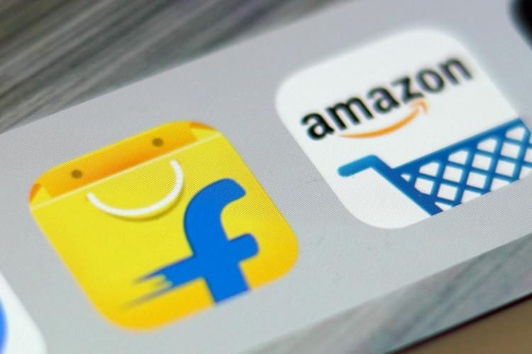 Icons of Flipkart and Amazon India next to each other