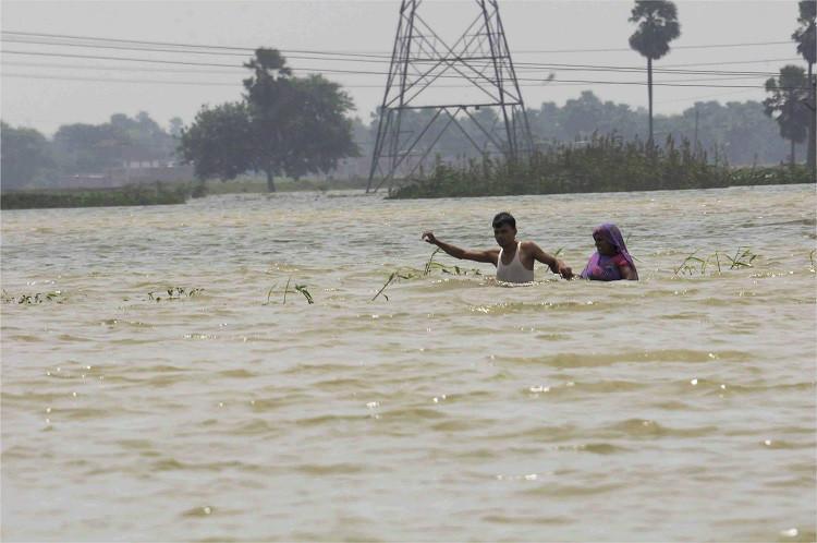 In pics Floods ravage Bihar UP as Ganga Yamuna cross danger mark