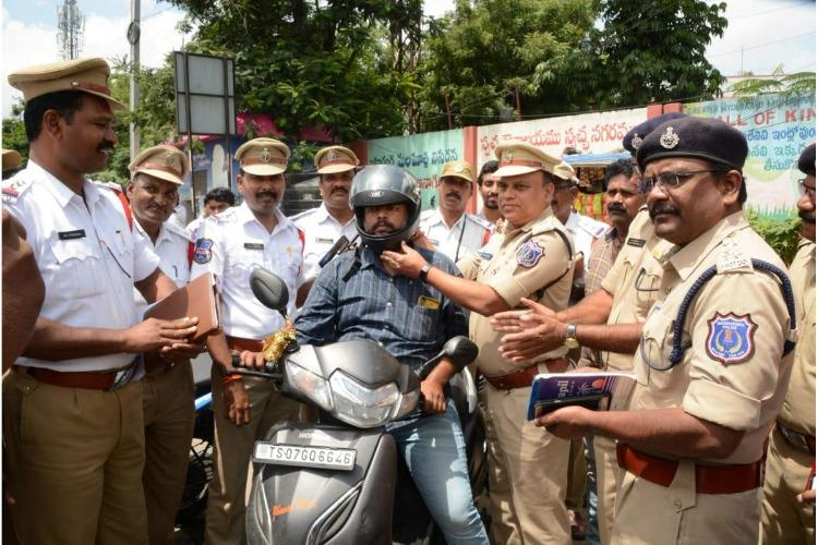 In Hyderabad cops give helmets instead of challans in unique initiative