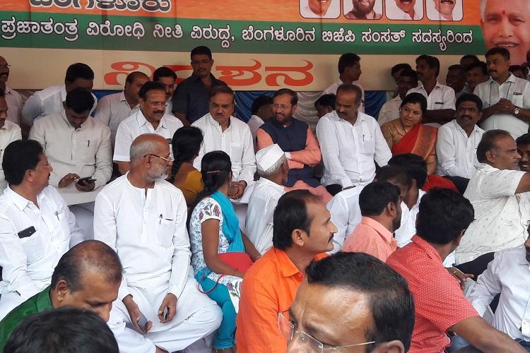 Protesting BJP blames Congress for disrupting parliament predicts victory in Karnataka