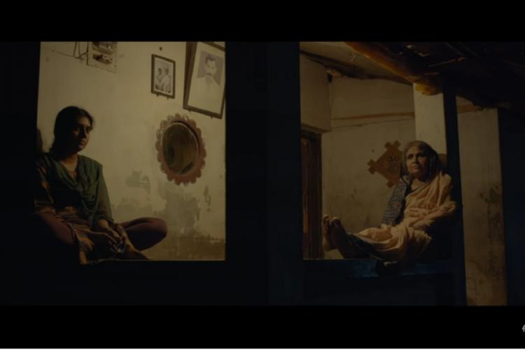 Nimisha Sajayan and Ambika Rao sit outside a house in a still from Ghar Se