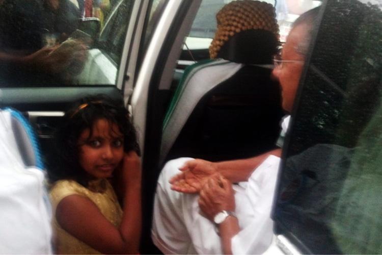 Kochi girl hands over gold earrings piggy bank savings to CM for flood relief